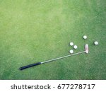 putter and golf balls on the... | Shutterstock . vector #677278717