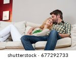 Small photo of Wife and husband on couch