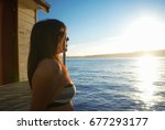 woman relaxing by boat house | Shutterstock . vector #677293177