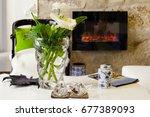 flower vase on table in a room...   Shutterstock . vector #677389093