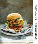 close up on big tasty hamburger ... | Shutterstock . vector #677440843