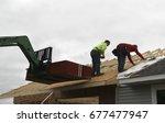 two contractors putting... | Shutterstock . vector #677477947