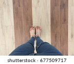 close up of bare feet with red... | Shutterstock . vector #677509717