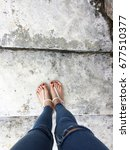 close up of bare feet with red... | Shutterstock . vector #677510377