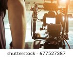 cameraman with his video camera ... | Shutterstock . vector #677527387