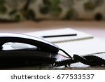home telephone on table closeup ... | Shutterstock . vector #677533537