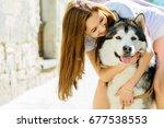 young long hair woman hugging... | Shutterstock . vector #677538553