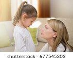 beautiful mother is comforting... | Shutterstock . vector #677545303
