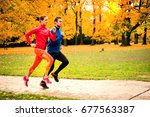 young couple jogging together... | Shutterstock . vector #677563387