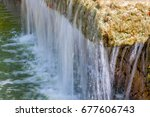 photo of a small waterfall | Shutterstock . vector #677606743