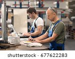 two worker in factory on work... | Shutterstock . vector #677622283