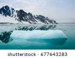 Iceberg And Mountains Are...
