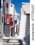 Small photo of Traditional greek alley of kora village, Mykonos island, Greece.
