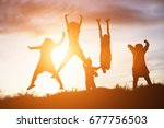 silhouette of a happy children... | Shutterstock . vector #677756503