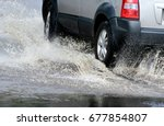 car splashes through a large... | Shutterstock . vector #677854807