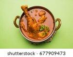 spicy reddish chicken curry  ... | Shutterstock . vector #677909473