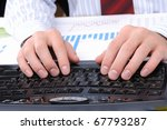a young business man working in ... | Shutterstock . vector #67793287