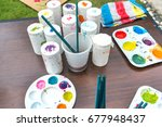 paint and brushes with  close... | Shutterstock . vector #677948437