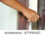 human hand opens the door.   Shutterstock . vector #677954107