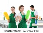 cleaning service team working... | Shutterstock . vector #677969143