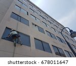 janitor suspended in mid air to ...   Shutterstock . vector #678011647