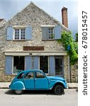 french house   blue shutters | Shutterstock . vector #678015457