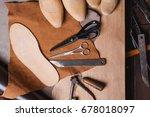 cobbler tools in workshop on a... | Shutterstock . vector #678018097