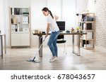happy young woman cleaning the... | Shutterstock . vector #678043657
