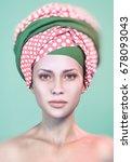 woman wearing african headscarf ... | Shutterstock . vector #678093043