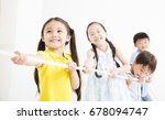 happy kids playing tug of war   | Shutterstock . vector #678094747