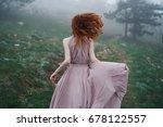 a woman runs through the forest ...   Shutterstock . vector #678122557