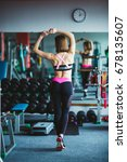beautiful young woman at gym. | Shutterstock . vector #678135607