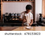 young african man pouring milk... | Shutterstock . vector #678153823