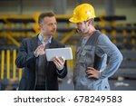 men in industrial building... | Shutterstock . vector #678249583
