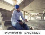 architect or builder siting on...   Shutterstock . vector #678268327