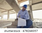 architect or builder siting on...   Shutterstock . vector #678268357