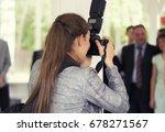 the girl photographer... | Shutterstock . vector #678271567