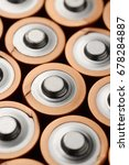 Small photo of Group of alkaline batteries. Top view macro shot