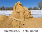 "Small photo of KOLOMENSKOYE, MOSCOW – MAY 2, 2013: Sand sculpture ""The battle of Siegfried with the dragon Fafnir"" at an exhibition of sand sculptures in Kolomenskoye."