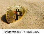golden bitcoin coin in the sand | Shutterstock . vector #678313327