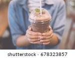 hand hold chocolate smoothie | Shutterstock . vector #678323857