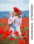 woman with child in poppy field....