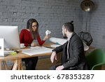 Small photo of Angry female chief executive officer wearing glasses feeling mad while having intense conversation with male employee in modern office, holding crumpled paper in her hand, telling him to remake report