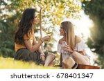 beautiful women drinking wine... | Shutterstock . vector #678401347