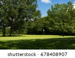 Sun Lit Putting Green And Whit...