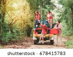 happy asian young travellers... | Shutterstock . vector #678415783