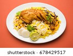 hyderabadi chicken or dum... | Shutterstock . vector #678429517