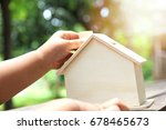 baby hands touch model house... | Shutterstock . vector #678465673