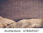 wood table with old sackcloth... | Shutterstock . vector #678469267