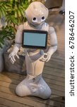 Small photo of YOKOHAMA, JAPAN - MAY 3, 2017: A popular Pepper humanoid robot with a touch display screen acts as the greeter at the entrance to a shop in Japan.